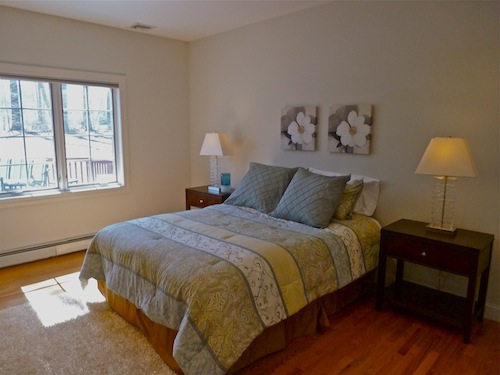 staging a bedroom.  After staging Guest Bedroom Photos Sell Your Home Faster By Making a Great Impression